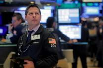 Wall Street strikes new high as housing data fuels optimism