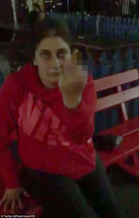 Women showing middle finger and abuses Indian man