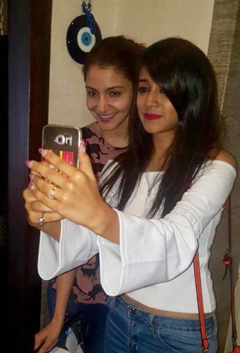 Anushka Sharma clicking a selfie with fan