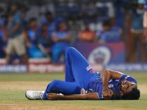 Physio helps injured Bumrah trudge off field